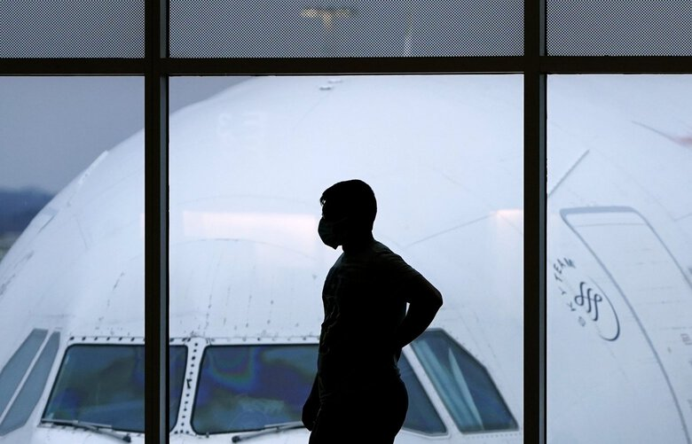 FILE – In this Feb. 18, 2021 file photo, a passenger wears a face mask to help prevent the spread of the new coronavirus as he waits for a Delta Airlines flight at Hartsfield-Jackson International Airport in Atlanta. Federal officials are seeking fines against 34 more airline passengers accused of unruly behavior, bringing the total of such penalties to more than $1 million this year. The Federal Aviation Administration said Thursday, Aug. 19, 2021 that the latest fines — which people can challenge — are part of its crackdown against incidents on planes, most of them involving passengers who refuse to wear face masks. (AP Photo/Charlie Riedel, file) NYPS206 NYPS206
