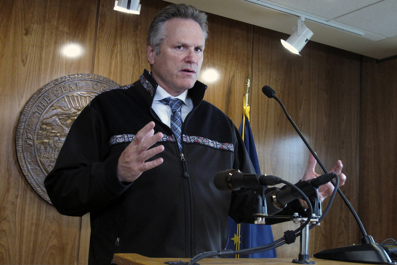 Alaska Gov. Mike Dunleavy speaks with reporters during a news conference, Monday, Aug. 16, 2021, in Juneau, Alaska. Dunleavy spoke before the scheduled start of a special legislative session on Monday. (AP Photo/Becky Bohrer)