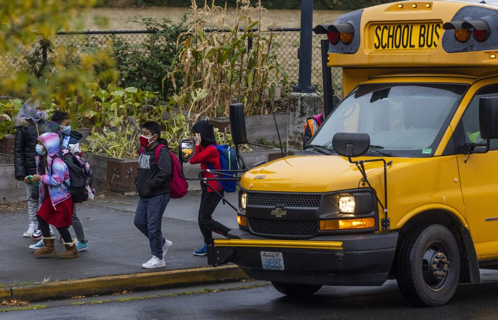 Students pass a school bus after being dropped off at Rising Star Elementary School on Friday, Sept. 17, 2021.  218246