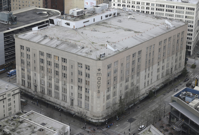 A big missing piece downtown is the former Macy's building between Third and Fourth Avenues in the heart of the retail core, pictured in 2016. Macy's closed in February 2020, and Amazon leases the upper floors as offices. (AP Photo / Ted S. Warren, File)
