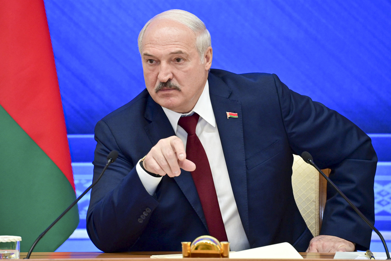 FILE – In this Monday, Aug. 9, 2021 file photo, Belarusian President Alexander Lukashenko gestures while speaking during an annual press conference in Minsk, Belarus. The authoritarian leader of Belarus said Wednesday Sept. 1, 2021, that the country will soon receive a large batch of Russian weapons, including dozens of combat jets, helicopters and top-of-the-line air defense missile systems. (Andrei Stasevich /BelTA photo via AP, File)
