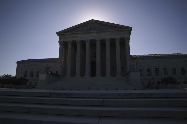 FILE – This June 29, 2021, file photo shows the U.S. Supreme Court on Capitol Hill in Washington. Traditionally, the process of getting an opinion from the U.S. Supreme Court takes months and those rulings are often narrowly tailored. Emergency orders, especially during the court's summer break, revolve around specific issues, like individual death penalty cases. But that pattern has changed in recent years with decisions coming outside the court's normal procedures. (AP Photo/J. Scott Applewhite, File)