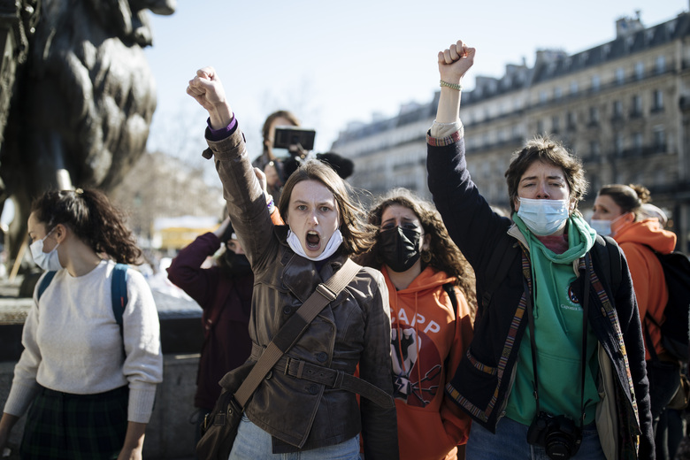 FILE – In this March 7, 2021 file photo, activists shout slogans, as protesters and activists gather at Republique square on the eve of the International Women's Day in Paris. France will offer free birth control to all women up to age 25 starting next year, the health minister announced Thursday. The measure will also include free medical visits around contraception, and will start Jan. 1, 2022 (AP Photo/Lewis Joly, File)