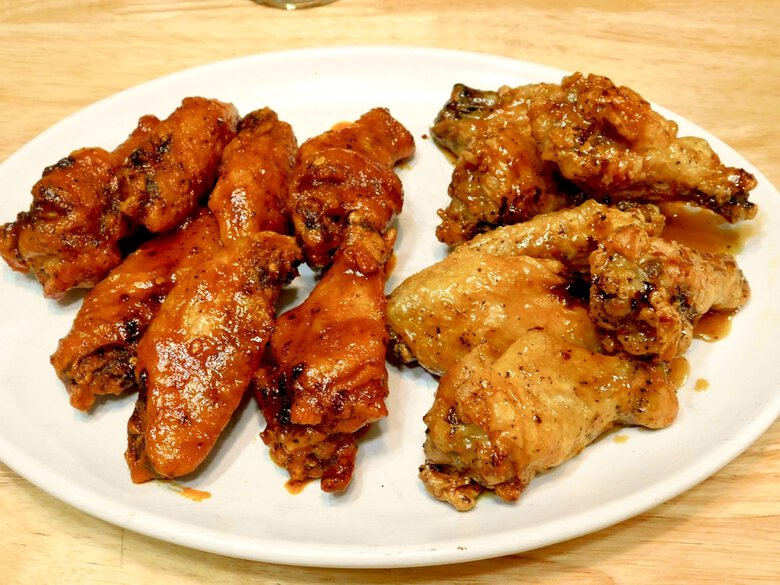 What's the secret to making crispy wings at home without having to deep-fry them? Baking powder and your oven. (Detria Turner / For The Seattle Times)