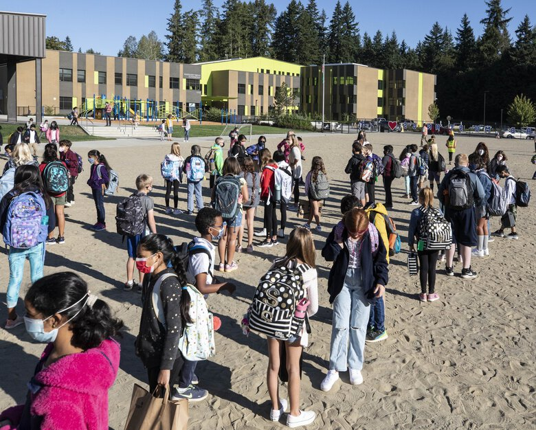 Kids line up on the first day of school Sept. 1 outside Margaret Mead Elementary in Sammamish before entering the school. (Steve Ringman / The Seattle Times)