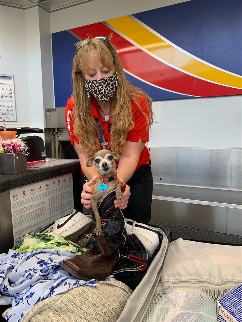 Southwest Airlines employee Cathy Cook and Icky. (Courtesy of Kristi Owens)